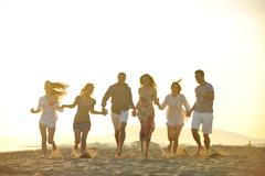 happy young  people group have fun on beach - stock photo