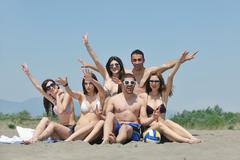 Stock Photo of group of happy young people in have fun at beach
