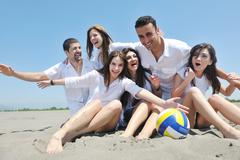 group of happy young people in have fun at beach - stock photo