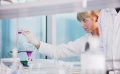 research and  science people  in laboratory - stock photo