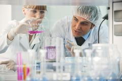 science people in bright lab - stock photo