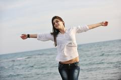 Stock Photo of young woman enjoy on beach