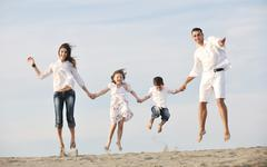 Stock Photo of happy young family have fun on beach