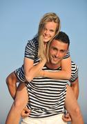 Happy young couple have romantic time on beach Stock Photos