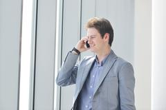 Stock Photo of young business man talk by cellphone