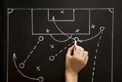 man drawing a soccer game strategy - stock photo