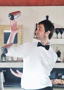 Stock Photo of pro barman prepare coctail drink on party