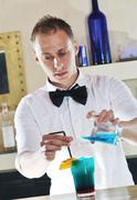 pro barman prepare coctail drink on party - stock photo
