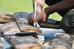 Wood worker with chainshaw closeup Stock Photos