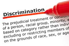 Discrimination underlined with red marker Stock Photos