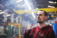 Industry worker smoke cigarette Stock Photos