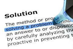 solving a problem highlighted under solution - stock photo