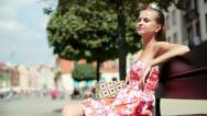 Young attractive happy woman relaxing in the city HD Stock Footage
