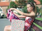 Happy woman checking her shopping bags in the city NTSC Stock Footage