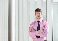 young business man alone in conference room - stock photo