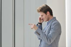 Young business man talk by cellphone Stock Photos