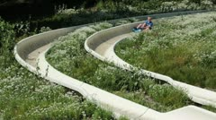 Alpine mountain slide boy having fun HD 2730 Stock Footage