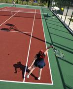 Stock Photo of young woman play tennis game outdoor