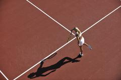 young woman play tennis outdoor - stock photo