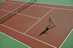 Stock Photo of young woman play tennis outdoor