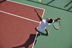 Stock Photo of young man play tennis outdoor