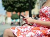 Happy young woman using smartphone in the city NTSC Stock Footage
