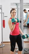 woman fitness workout with weights - stock photo