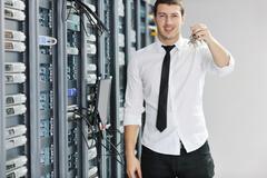 young it engeneer in datacenter server room - stock photo