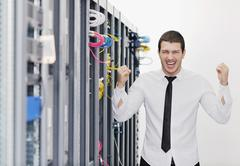 young it engeneer in datacenter server room - stock photo