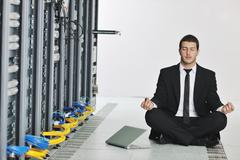 Business man practice yoga at network server room Stock Photos