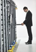 young engeneer in datacenter server room - stock photo