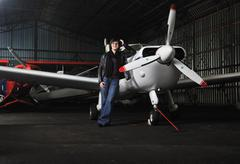 young woman with private airplane - stock photo