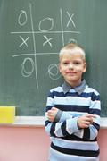 Happy young boy at first grade math classes Stock Photos