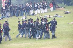 union infantry maneuvers during a mock civil war battle - stock photo