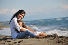 Stock Photo of mom and daughter portrait on beach