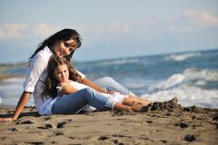mom and daughter portrait on beach - stock photo