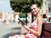 Happy young woman with tablet computer in the city NTSC Stock Footage