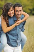 happy young couple have romantic time outdoor - stock photo