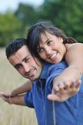 Stock Photo of happy young couple have romantic time outdoor