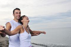 happy young couple have fun at beautiful beach - stock photo