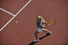 Young woman play tennis Stock Photos