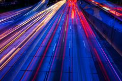 Freeway traffic at night Stock Photos