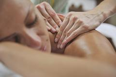 woman back massage treatment - stock photo
