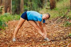 Stock Photo of runner stretching