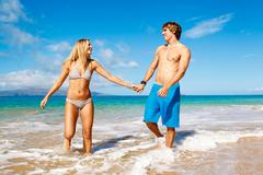 young couple on tropical beach - stock photo