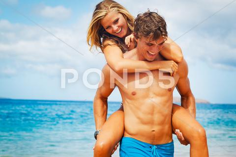 Stock photo of young couple on tropical beach