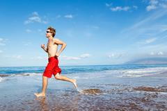 runner on beach - stock photo