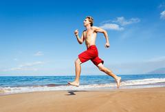 Runner on beach Stock Photos
