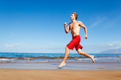 Stock Photo of runner on beach