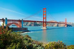 the golden gate bridge in san francisco with beautiful blue ocean in backgrou - stock photo